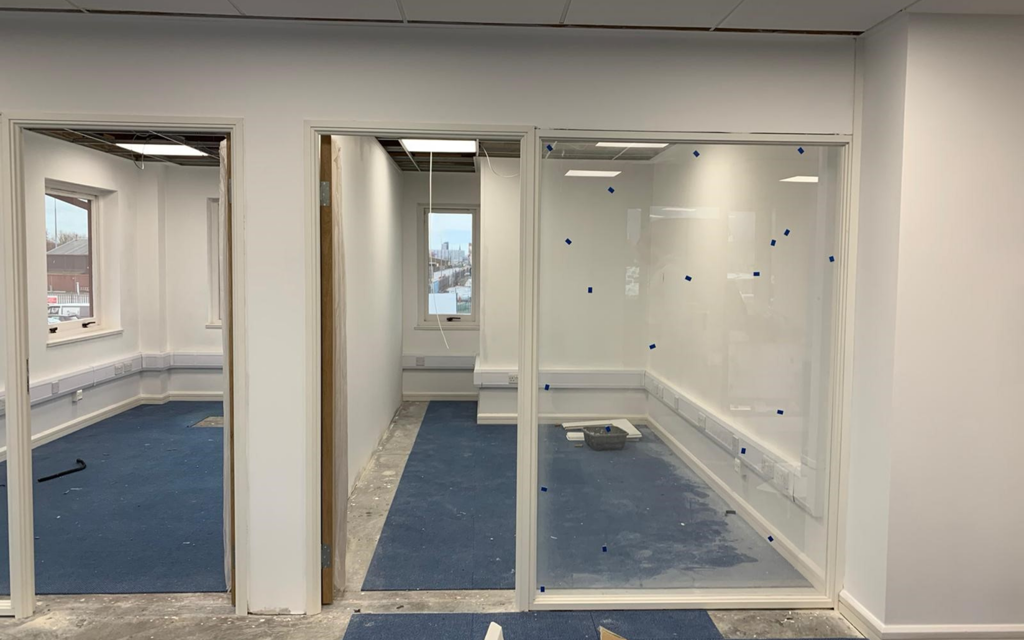 Glazed partitions to the offices